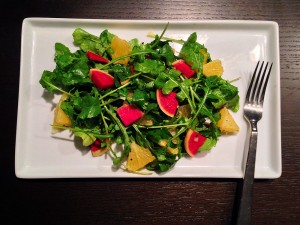 Winter salad with arugula, citrus, and watermelon radishes